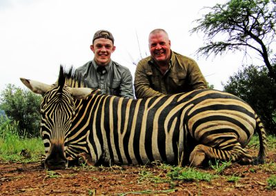 Father and son hunting Africa zebra