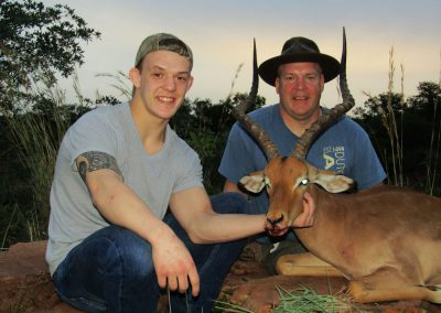 Father and Son hunting in Africa impala