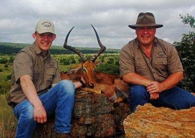 Father and son hunting impala South Africa