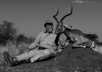 Hunting impala with rifle