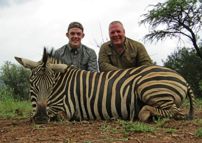 Father and Son hunting in Africa zebra
