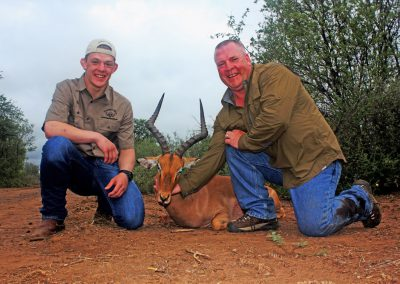 Father and Son hunting in South Africa impala