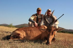 Brothers hunting in Africa